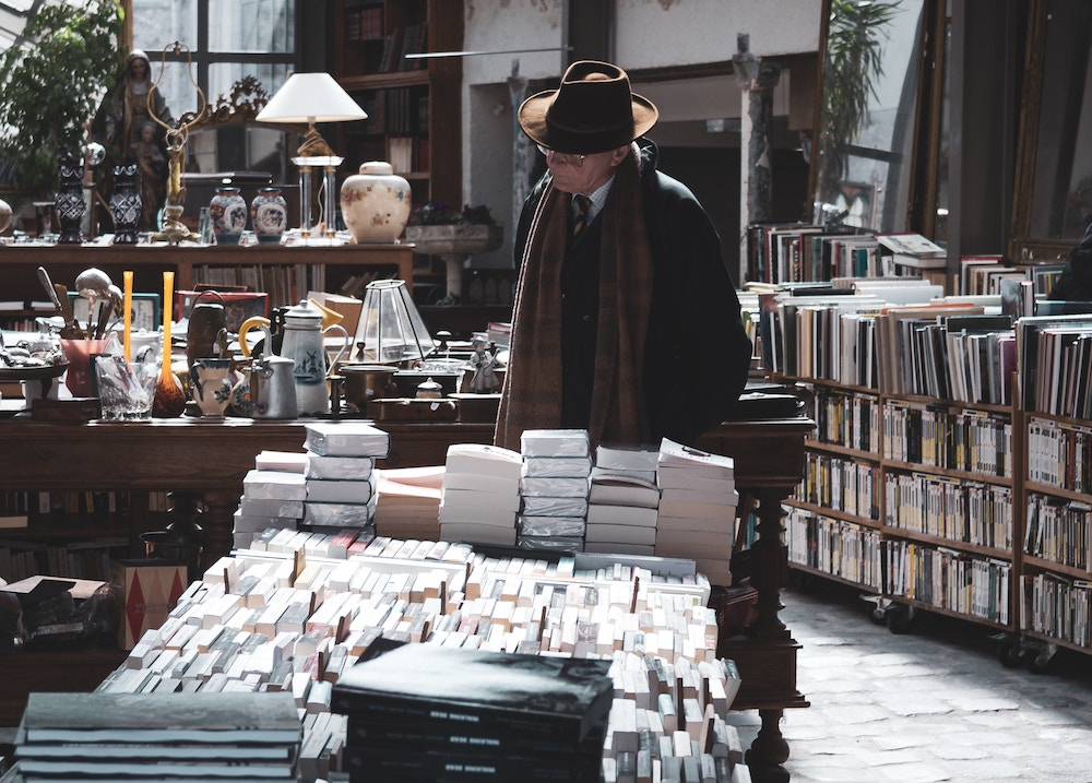 man looking at books