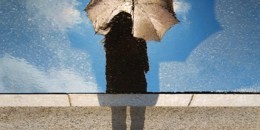 reflection of girl in puddle